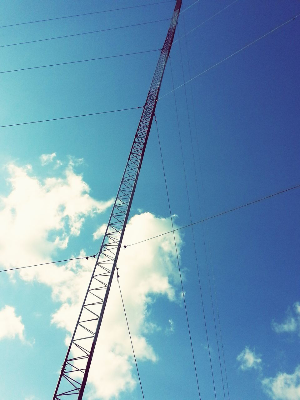 cable, low angle view, sky, power line, blue, power supply, connection, no people, day, electricity, outdoors, electricity pylon, technology, telephone line, nature