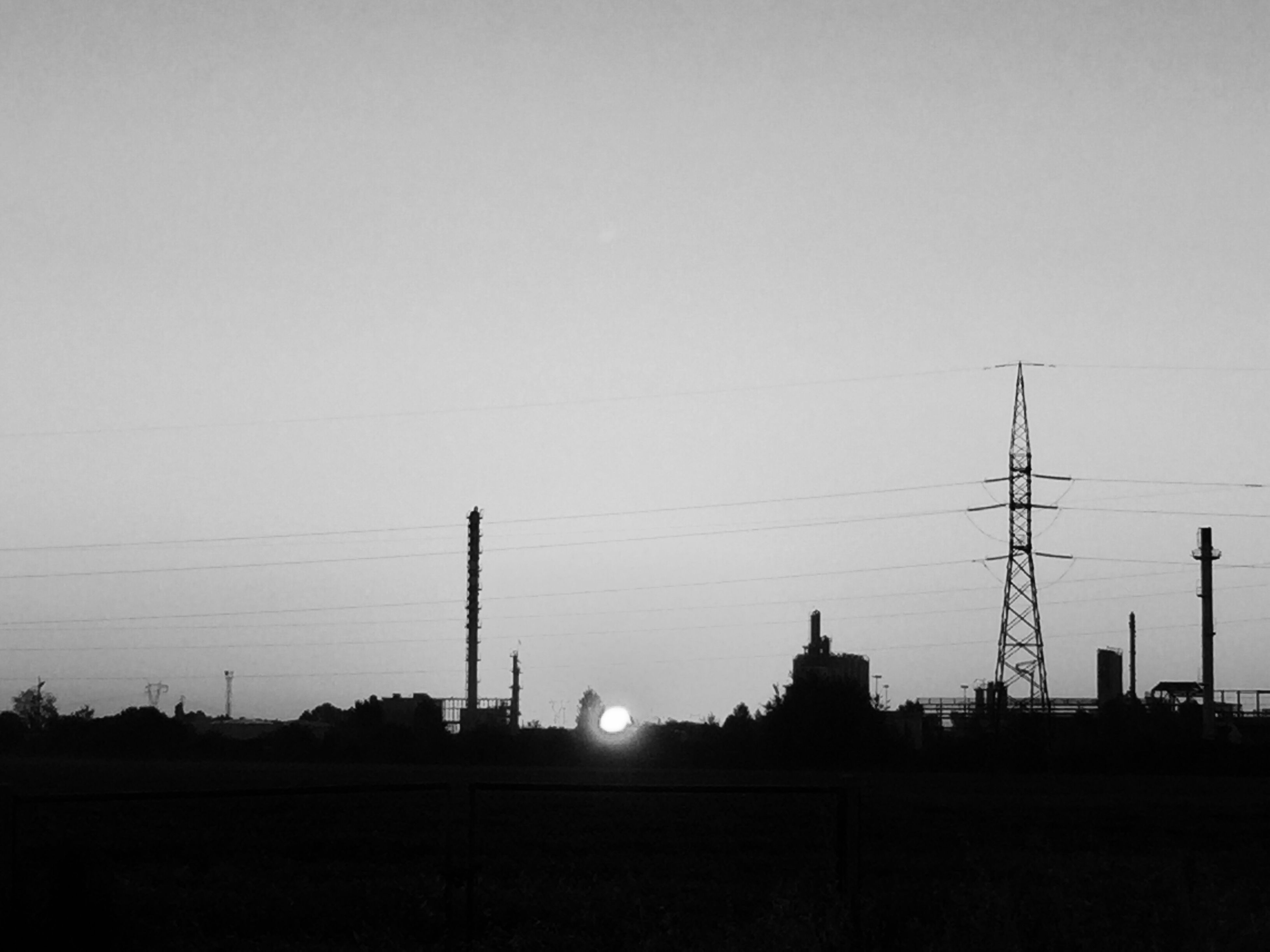 silhouette, electricity pylon, power line, clear sky, sun, electricity, power supply, cable, sky, outline, tranquil scene, tall, tranquility, outdoors, calm, electricity tower, no people, scenics