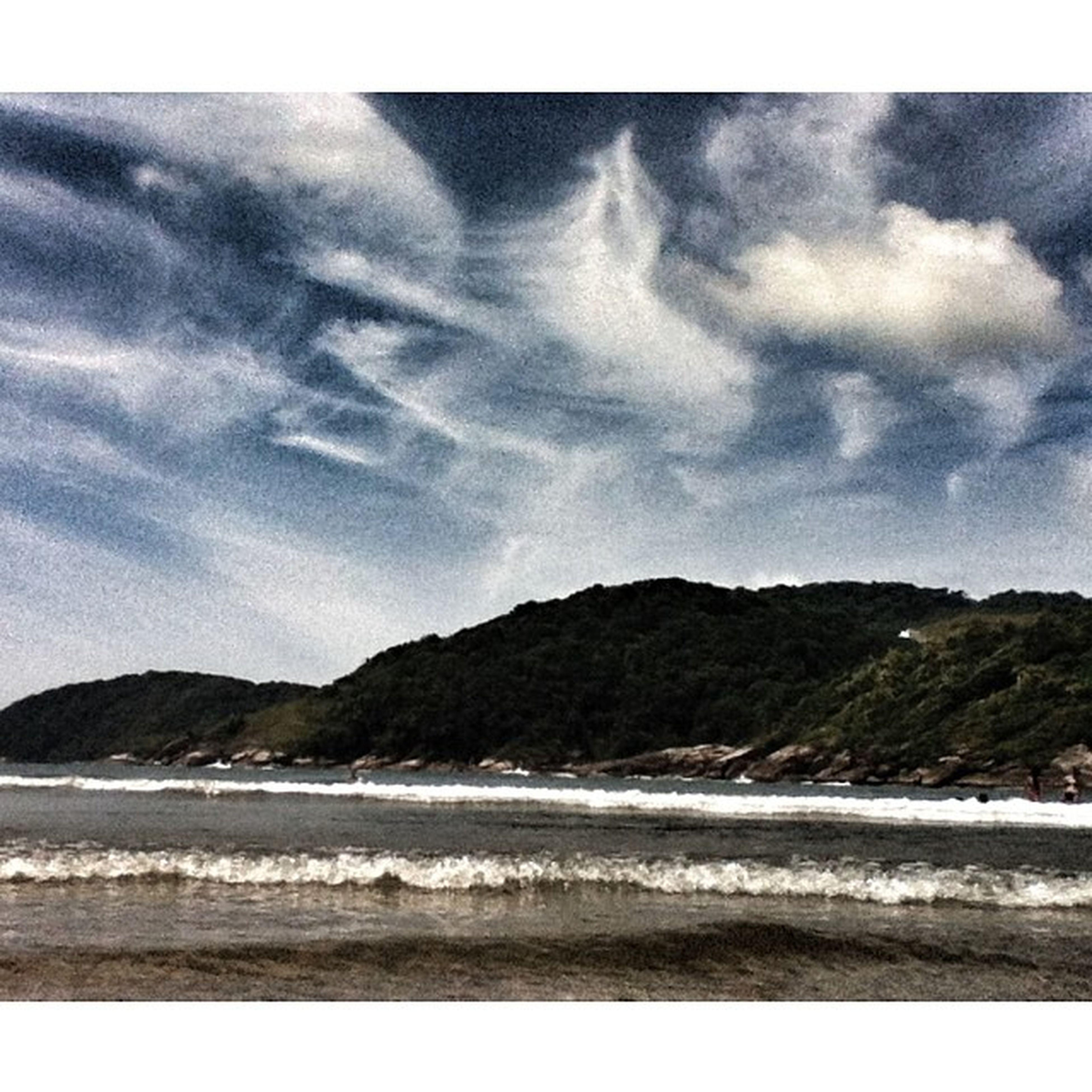 water, mountain, sky, tranquil scene, scenics, tranquility, beauty in nature, sea, cloud - sky, mountain range, beach, nature, cloudy, cloud, shore, idyllic, coastline, lake, outdoors, non-urban scene