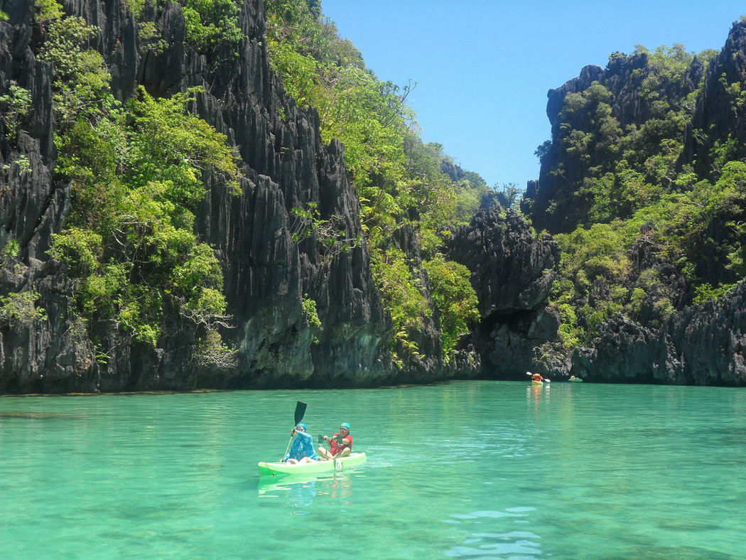 Russian couple kayaking in the clear waters of El Nido, PalawanThe Great Outdoors - 2016 EyeEm Awards dSmall Lagoon oEl Nido dPalawan aPhilippines eEyeem Philippines eKayaking nBeautiful Views wAmazing Views wBeautiful Destinations nAmazing Earth tLonely Planet eKarst sKarst Mountain iLimestone Rocks kLimestone Walls lItsmorefuninthephilippines eLandscape pLandscapes eLandscape_photography hSeascape pSeascapes eSeascape Photography People Of The Oceans Live For The Story