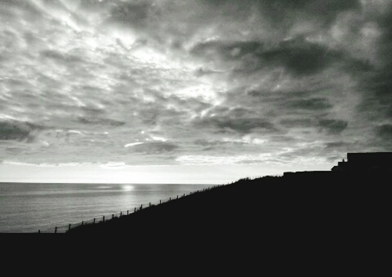 Blackandwhite Clifftop Peacehaven Beachphotography EyeEm Gallery EyeEm Best Shots EyeEm Nature Lover Silhouette Tranquil Scene Water Tranquility Sea Sky Scenics Dusk Calm Cloud Dark Beauty In Nature Nature Cloud - Sky Cloudscape Outdoors Outline Cloudy
