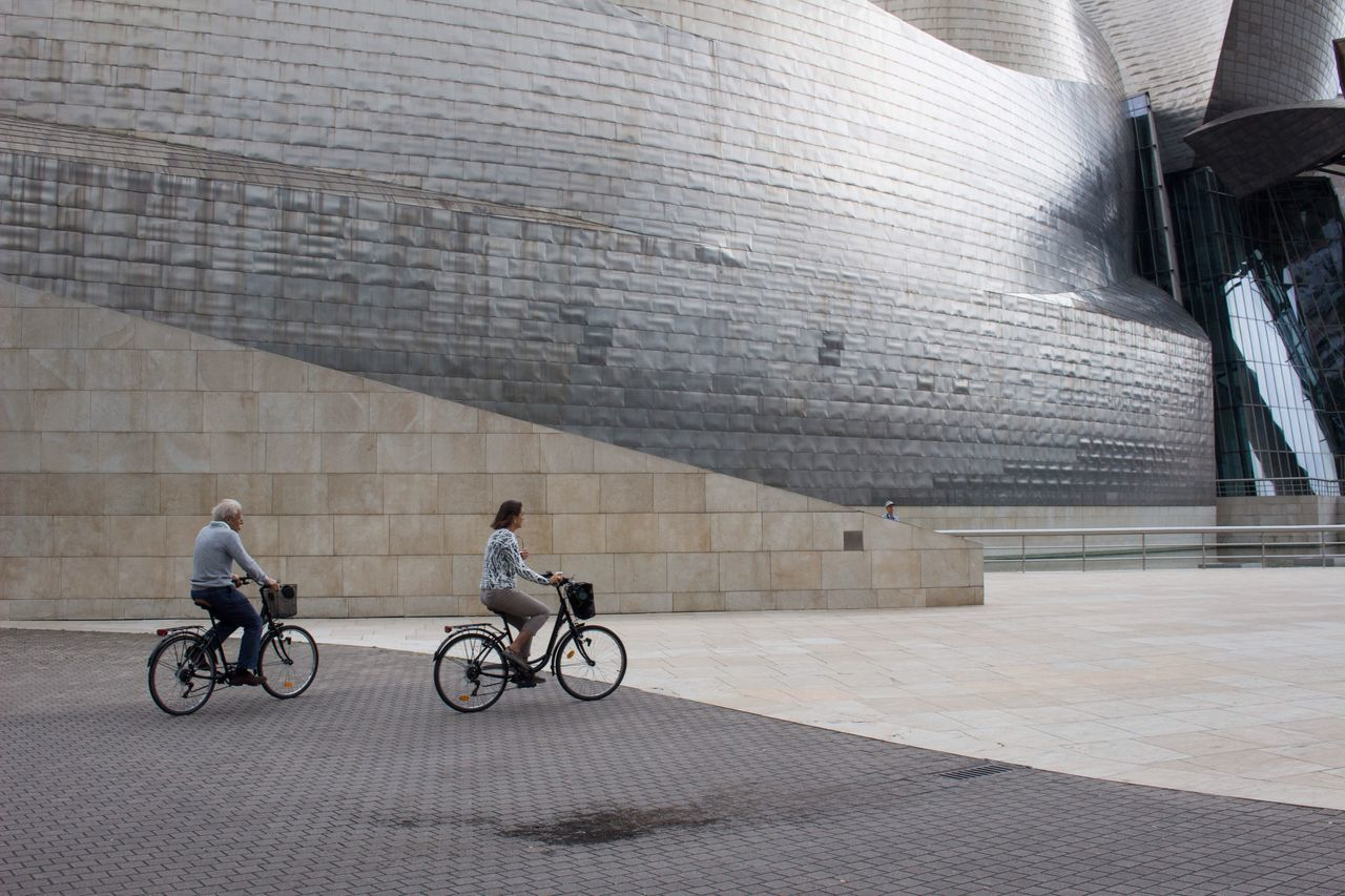 Let's Go. Together. Bike Bikes Two Two People Transportation Bicycle Architecture Outdoors Togetherness Day Adult City Guggenheim Gugenhain Museum EyeEm Selects Breathing Space