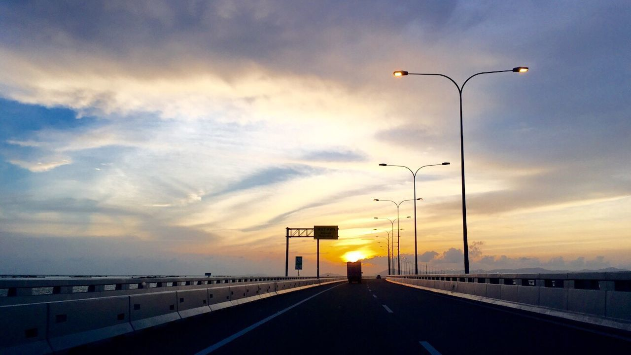 Sunset over the Penang bridge. Sky Street Light Road Sunset Cloud - Sky No People Road Sign Architecture Illuminated Traffic Signal Nature Architecture Travel Sunset And Clouds  Road Penang Malaysia