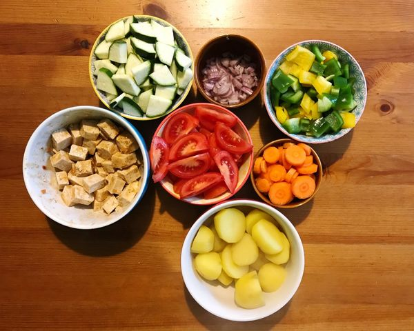 Vegetables Vegetarian Food Tomatoes Onions Bell Pepper Tofu Carrot Potato Healthy Eating Variation Bowl Food Food And Drink Vegetable Table High Angle View Freshness Indoors  No People Preparation  Choice SLICE Close-up