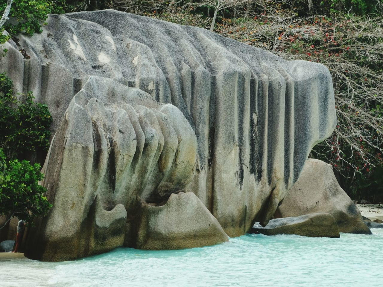 Nature No People Day Outdoors Beauty In Nature Water Rock Formation Rocks In Water Indian Ocean Tropical Paradise Seychelles Islands La Digue Seychelles Cliff Beauty In Nature Rock - Object Island Tropical Climate