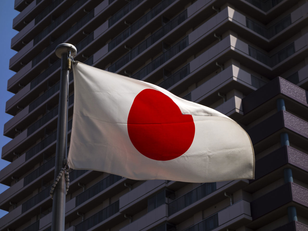 Japanese flag on a national holiday Banner Close-up Day Flag Flame Hinomaru Hoisted Banners Hoisted Flag Hoisting Japan Low Angle View National Holiday National Symbol No People Official Outdoors Patriotism Pattern Red Red On White White Color