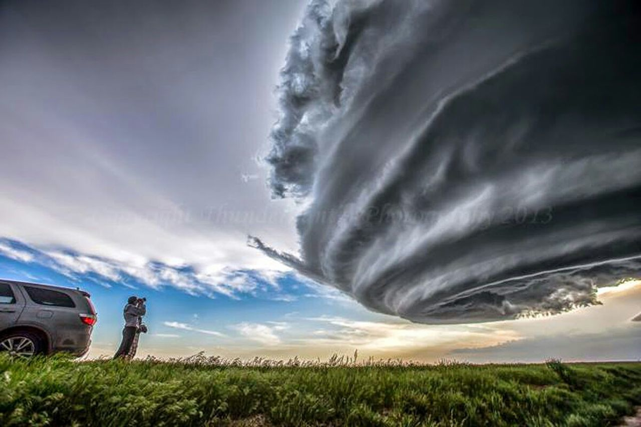car, cloud - sky, storm, dramatic sky, thunderstorm, tornado, storm cloud, power in nature, weather, mode of transport, nature, sky, rural scene, field, horizon over land, alternative energy, cyclone, outdoors, agriculture, transportation, scenics, day, cereal plant, no people, beauty in nature