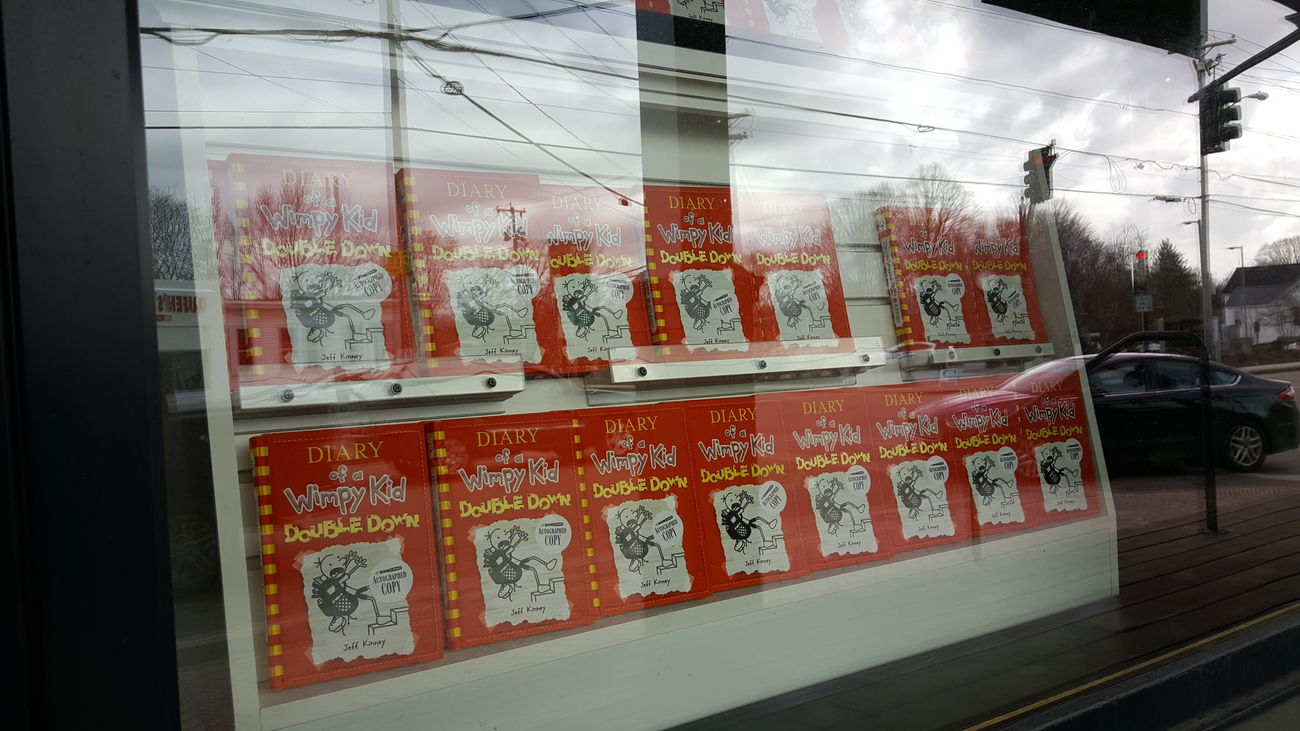 Reflections of a Wimpy Kid. Text Books Day Close-up Retail Display No People Outdoors Reflection In The Window EyeEm Best Shots