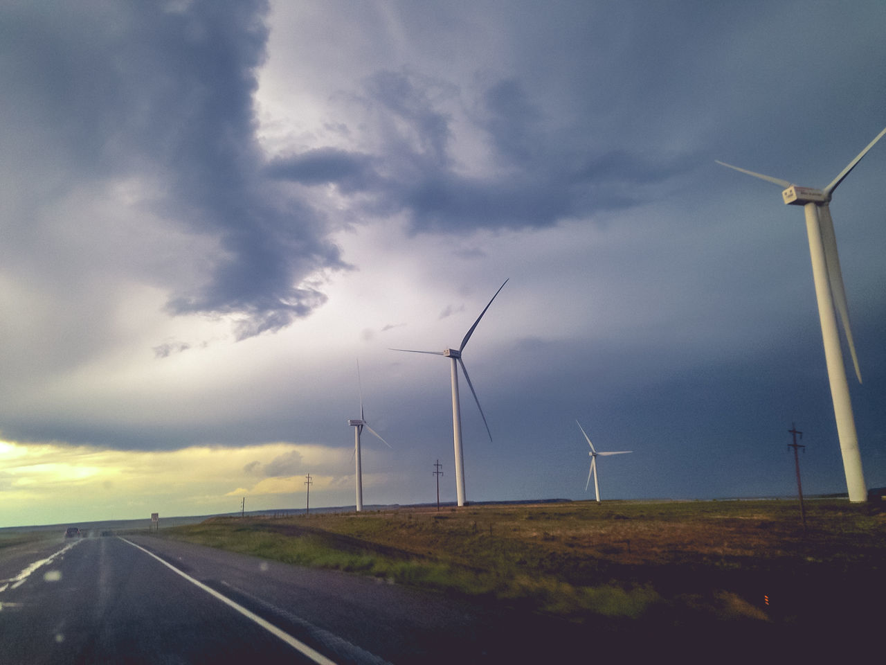 wind turbine, environmental conservation, wind power, alternative energy, renewable energy, windmill, fuel and power generation, industrial windmill, cloud - sky, sky, road, rural scene, no people, outdoors, day, nature