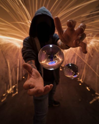 Crystal Ball Reflection Holding Indoors  Real People One Person Childhood Men Human Hand Illuminated Human Body Part Fragility Close-up Bubble Wand Day People