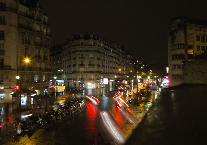 Architecture Building Exterior Built Structure City Clock Face Illuminated Light Trail Long Exposure Motion Night No People Outdoors Paris Road Sky Traffic Trail Lights Transportation Travel Destinations Adapted To The City