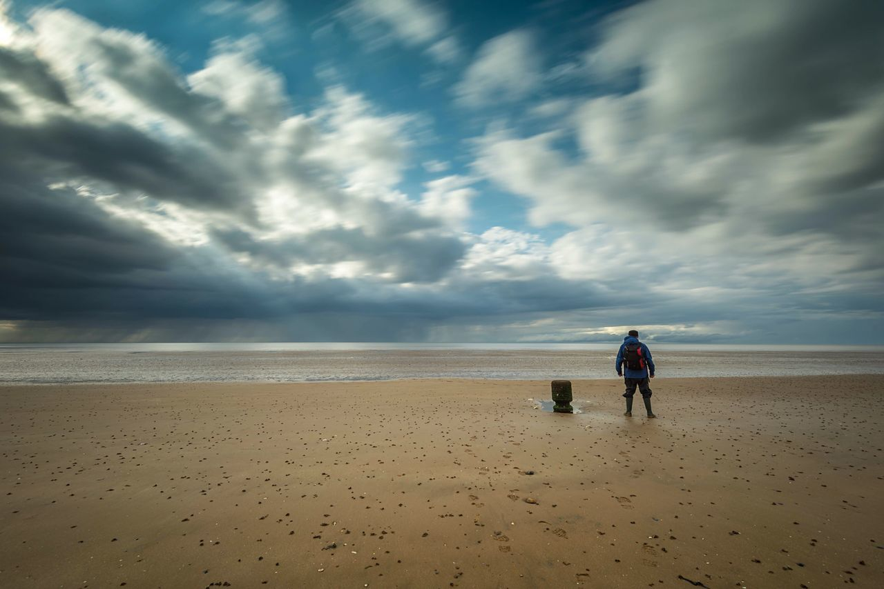 Echoes Beach Sand Sea Cloud - Sky Horizon Over Water Sky Nature Full Length Tranquility Beauty In Nature Boys Real People Scenics Water Day Childhood Outdoors The Great Outdoors - 2017 EyeEm Awards Landscape_Collection Long Exposure One Person Vacations Standing Beach Walk Sand & Sea
