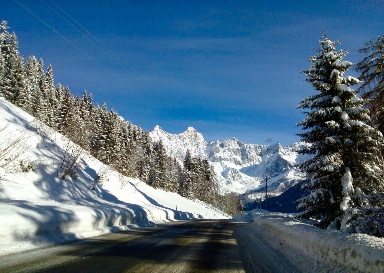 Austria Beauty In Nature Cold Temperature Day Landscape Mountain Mountain Range Nature No People Outdoors Road Scenics Sky Snow The Way Forward Tranquil Scene Tranquility Tree Winding Road Winter