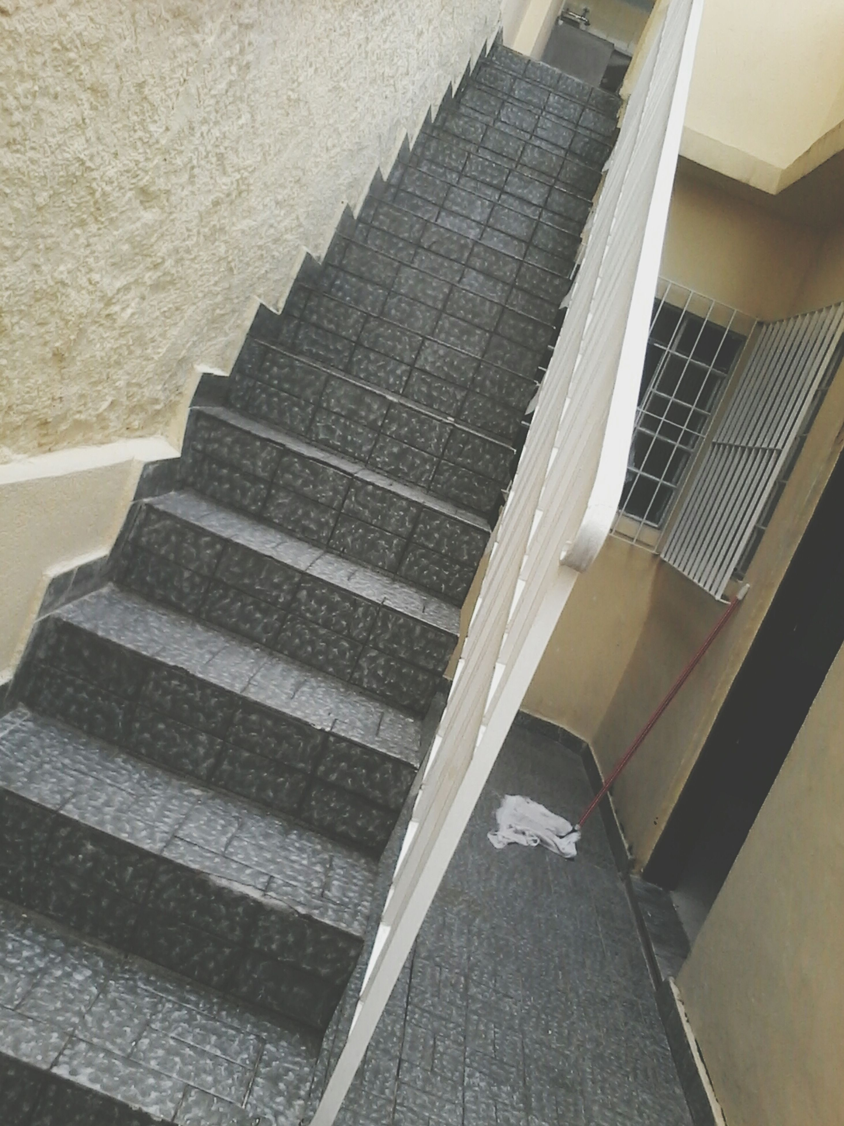 architecture, built structure, steps, steps and staircases, staircase, indoors, building exterior, high angle view, railing, building, low angle view, modern, wall - building feature, sunlight, no people, shadow, the way forward, day, stairs, pattern