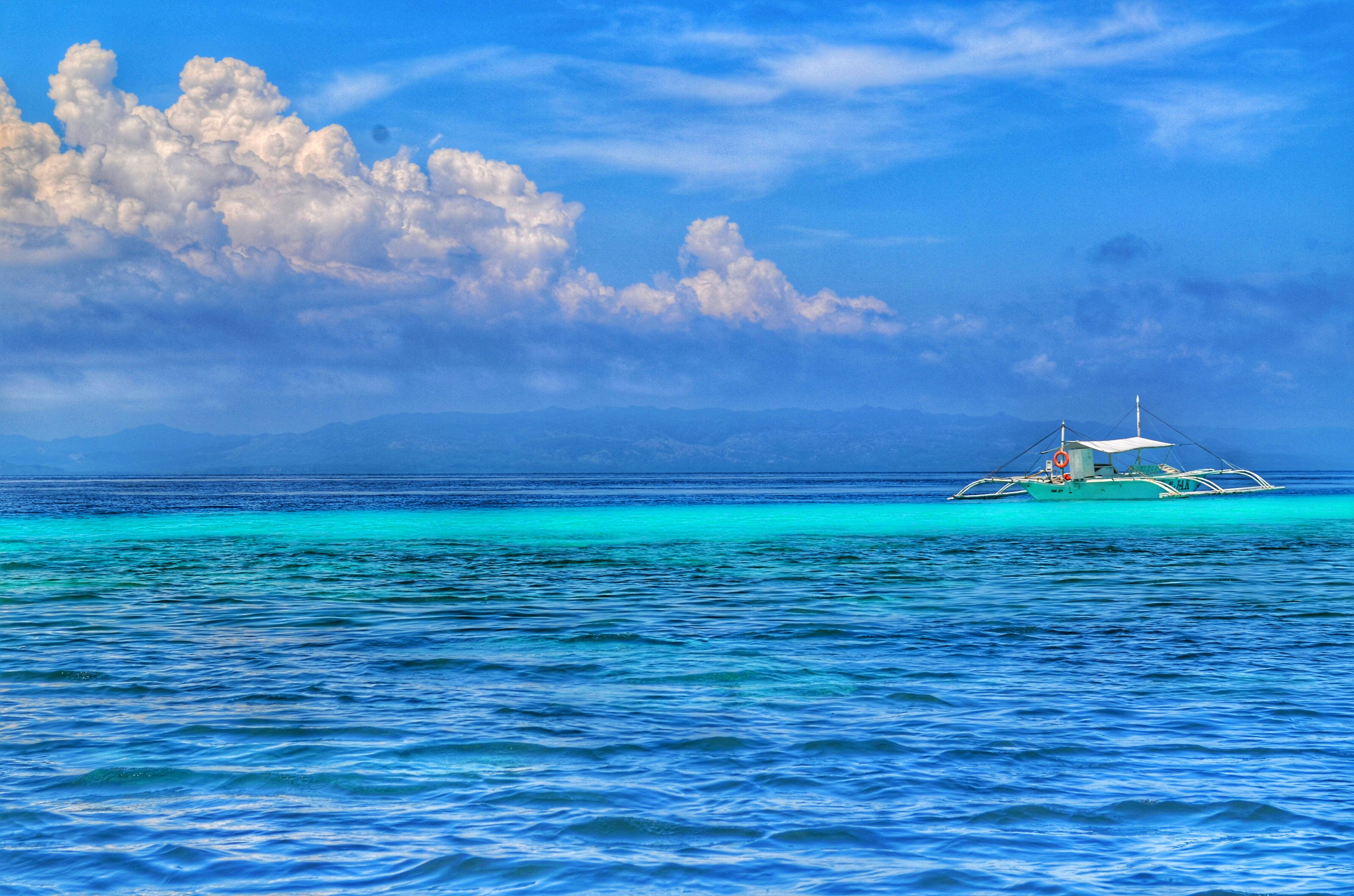 sea, water, sky, blue, waterfront, tranquil scene, horizon over water, tranquility, scenics, nautical vessel, cloud - sky, beauty in nature, rippled, cloud, nature, transportation, boat, idyllic, cloudy, seascape