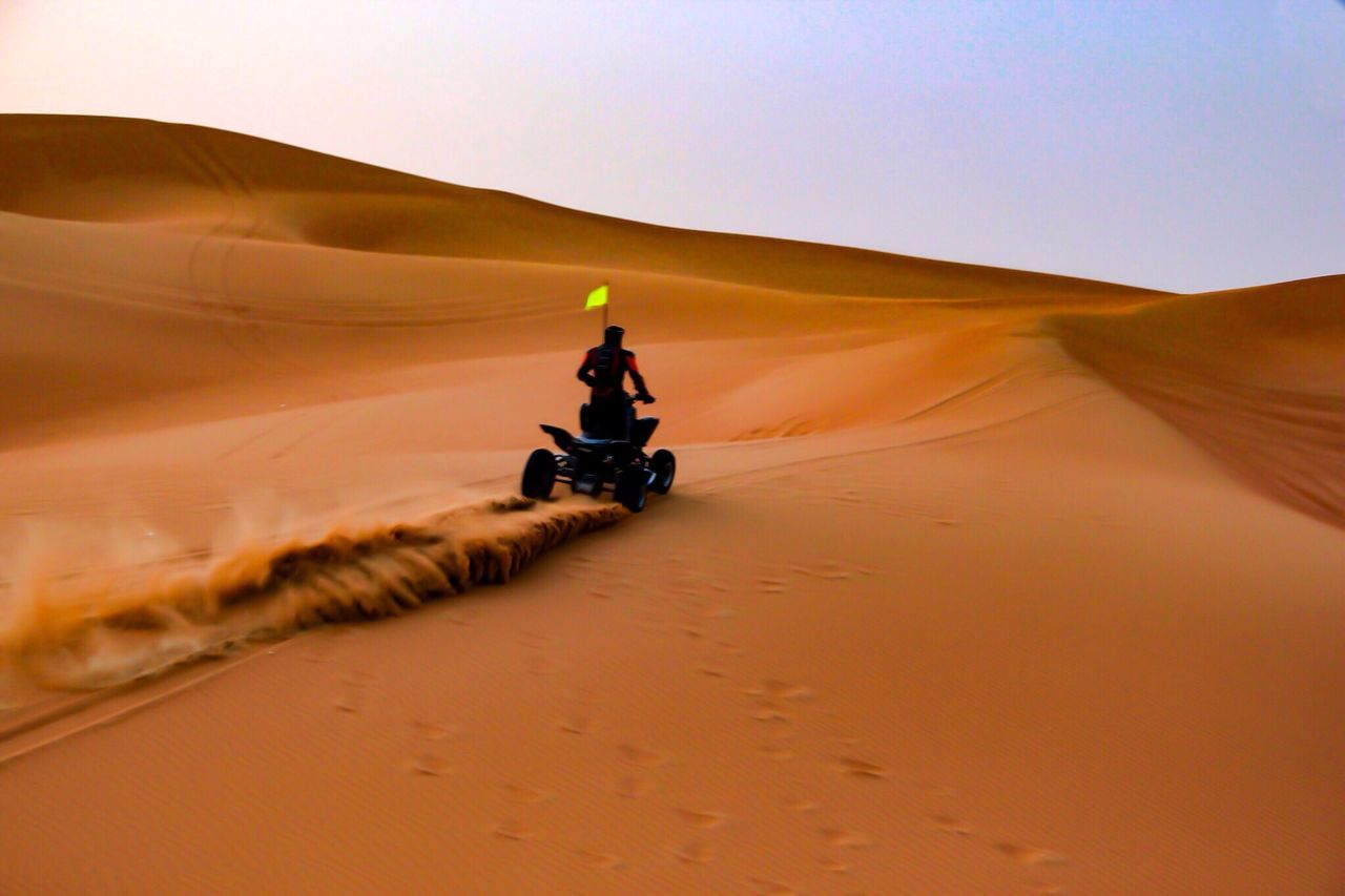 Miles Away Desert Sand Dune Sand Arid Climate Off-road Vehicle Landscape Travel Outdoors Riding Land Vehicle Nature Real People Day One Person Tire Track Adventure Sky Motorsport Dubai The Great Outdoors - 2017 EyeEm Awards