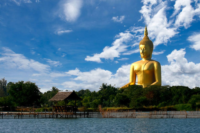 Huge golden Buddha statue on a clear day. Buddha Statue BIG Gold Open Edit Sky Clouds Clouds And Sky Travel Thailand
