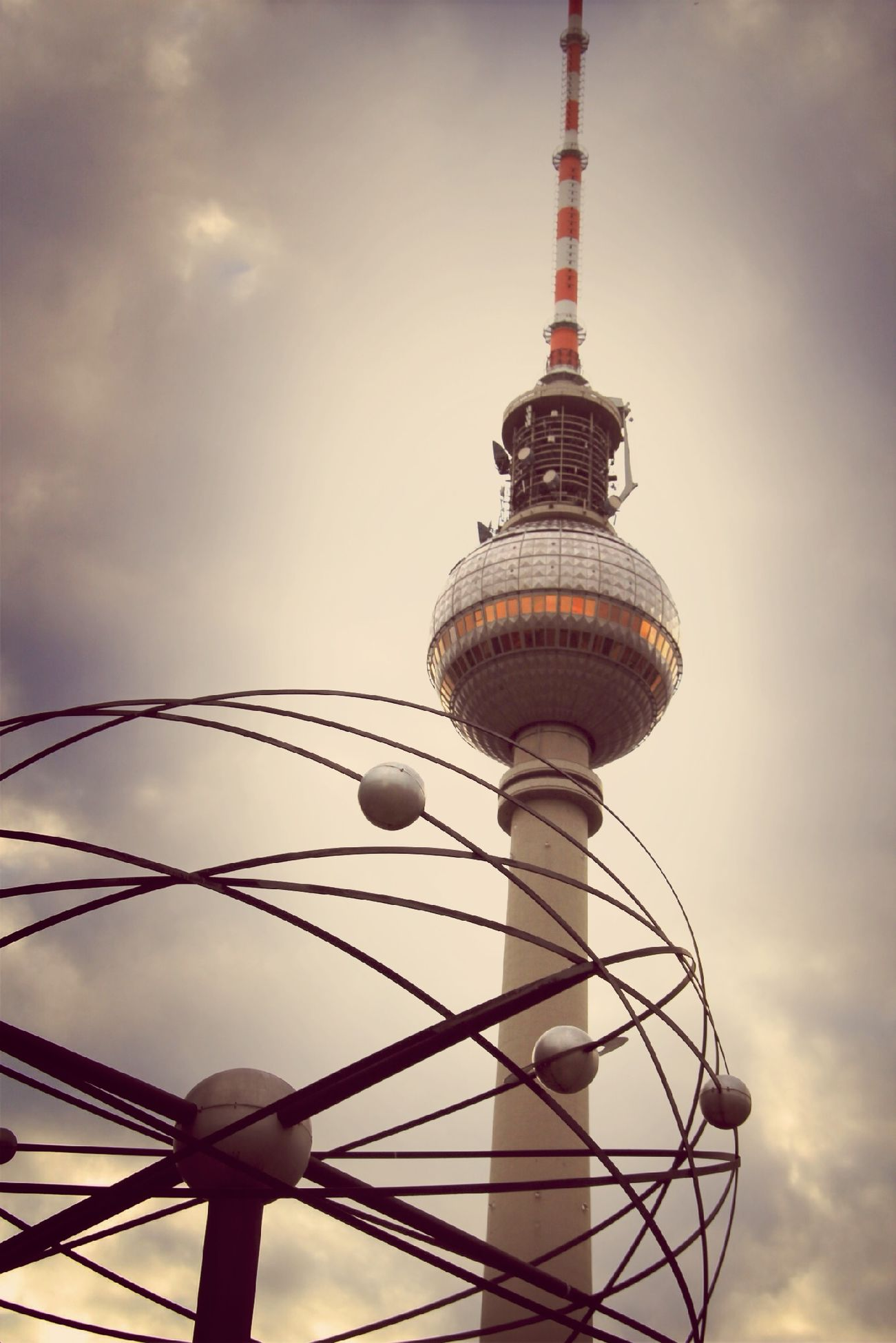 tower, architecture, built structure, tall - high, low angle view, communications tower, international landmark, travel destinations, tourism, famous place, capital cities, sky, travel, building exterior, communication, television tower, fernsehturm, spire, city, sphere