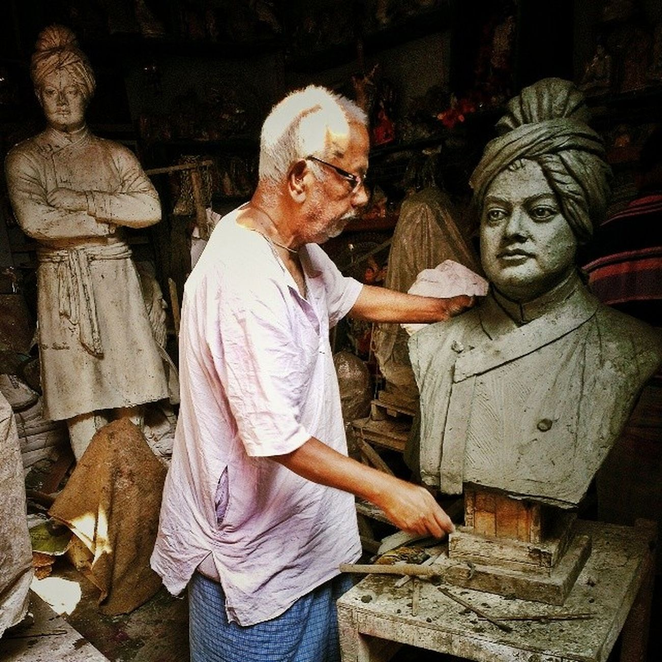 The master craftsman at work in Kumartuli on the Goddess Beckons Tour. It is really humbling to see him work. A lifetime's experience in every deft move he makes. Incrediblecalcutta GoddessBeckonsTour Artisans clay Calcutta calcuttaphototours vivekananda