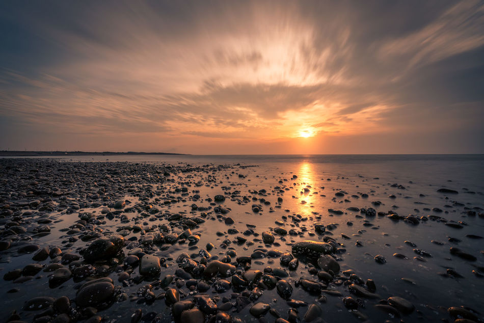 Sunset at Taoyuan, Taiwan Beach Beauty In Nature Cloud Cloud - Sky Clouds And Sky Day Horizon Over Water Nature No People Orange Outdoors Reflection Scenics Sea Sky Sun Sunset Taiwan Taking Photos Tranquil Scene Tranquility Water