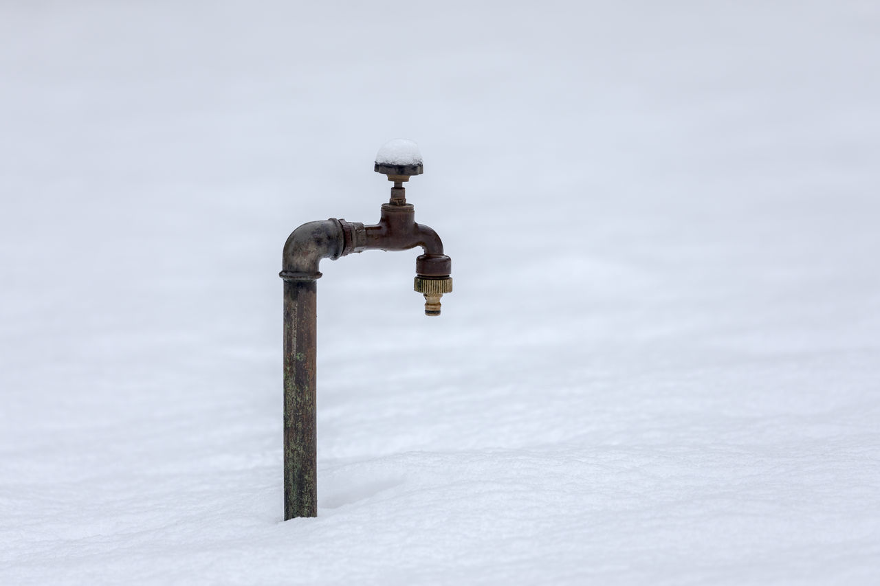 Cold Temperature Copy Space Day Faucet Focus On Foreground Metal Metallic Nature No People Outdoors Purity Selective Focus Simplicity Snow Snowing Water Pipe Winter