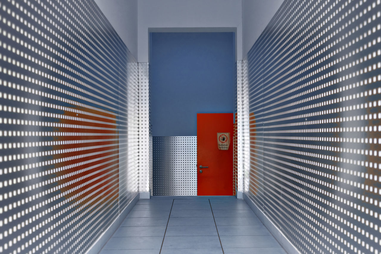 Emptiness Modern Architecture No Entry Red Door Reflection Symetry Architecture Blue Wall Building Exterior Building Interior Built Structure Day Deserted Door Floor Indoors  Lines And Shapes Metal Panels No People Pattern Tiles Tranquil Scene