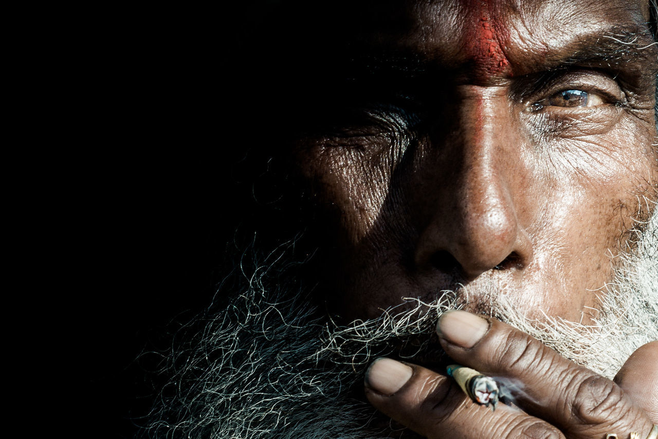 Adults Only Black Background Close-up Facial Hair Front View Human Body Part Human Face Indian Indian Culture  Indiapictures Mature Adult Men One Man Only One Person Only Men People Portrait Real People Smoking The City Light