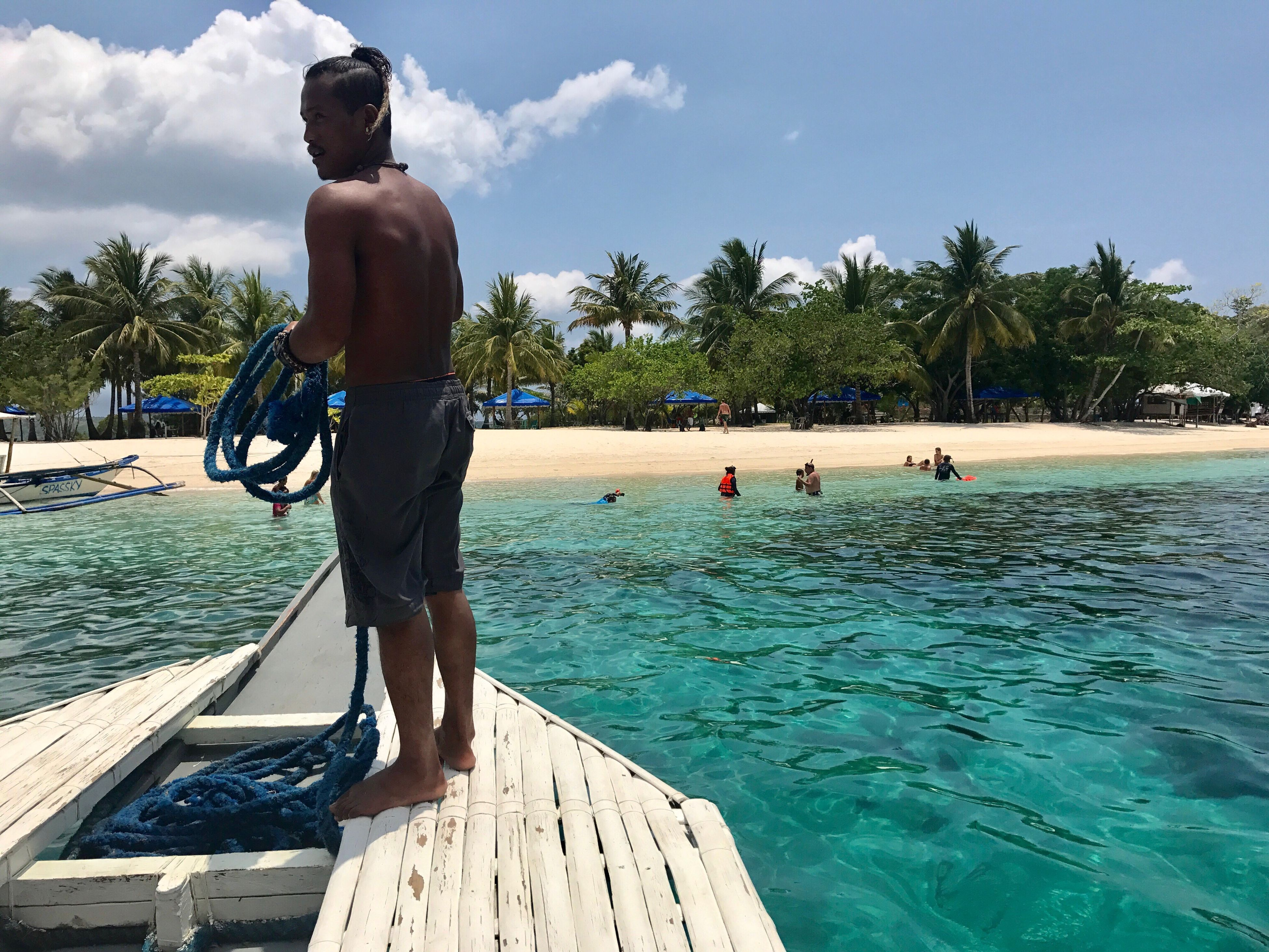 real people, water, men, shirtless, sky, lifestyles, leisure activity, day, sea, cloud - sky, nature, rear view, outdoors, beauty in nature, nautical vessel, standing, tree, adventure, one person, people