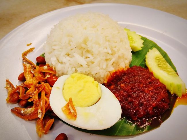 Local cuisine, Nasi Lemak Local Food Food Plate Freshness Ready-to-eat Healthy Eating Close-up Nasi Lemak For Breakfast Egg Anchovies Spicy Tasty Chili  Hot Cuisine Eat Rice Cucumber Served On Plate