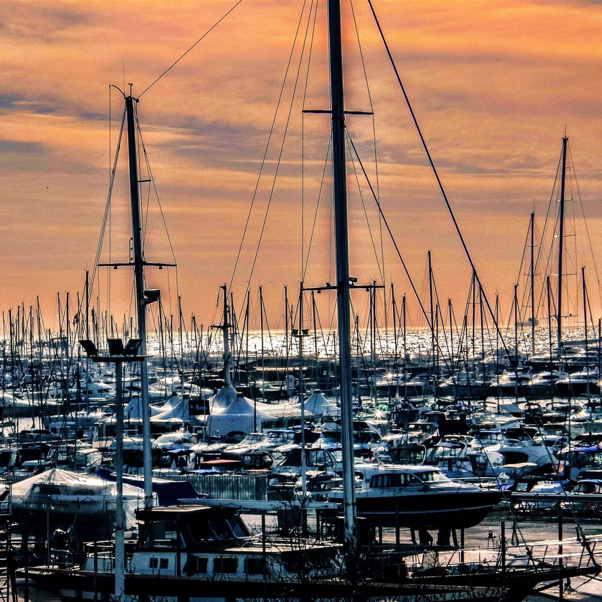 nautical vessel, mast, transportation, moored, boat, mode of transport, sunset, harbor, sailboat, water, sky, sea, cloud - sky, orange color, travel, marina, no people, outdoors, nature, cloud