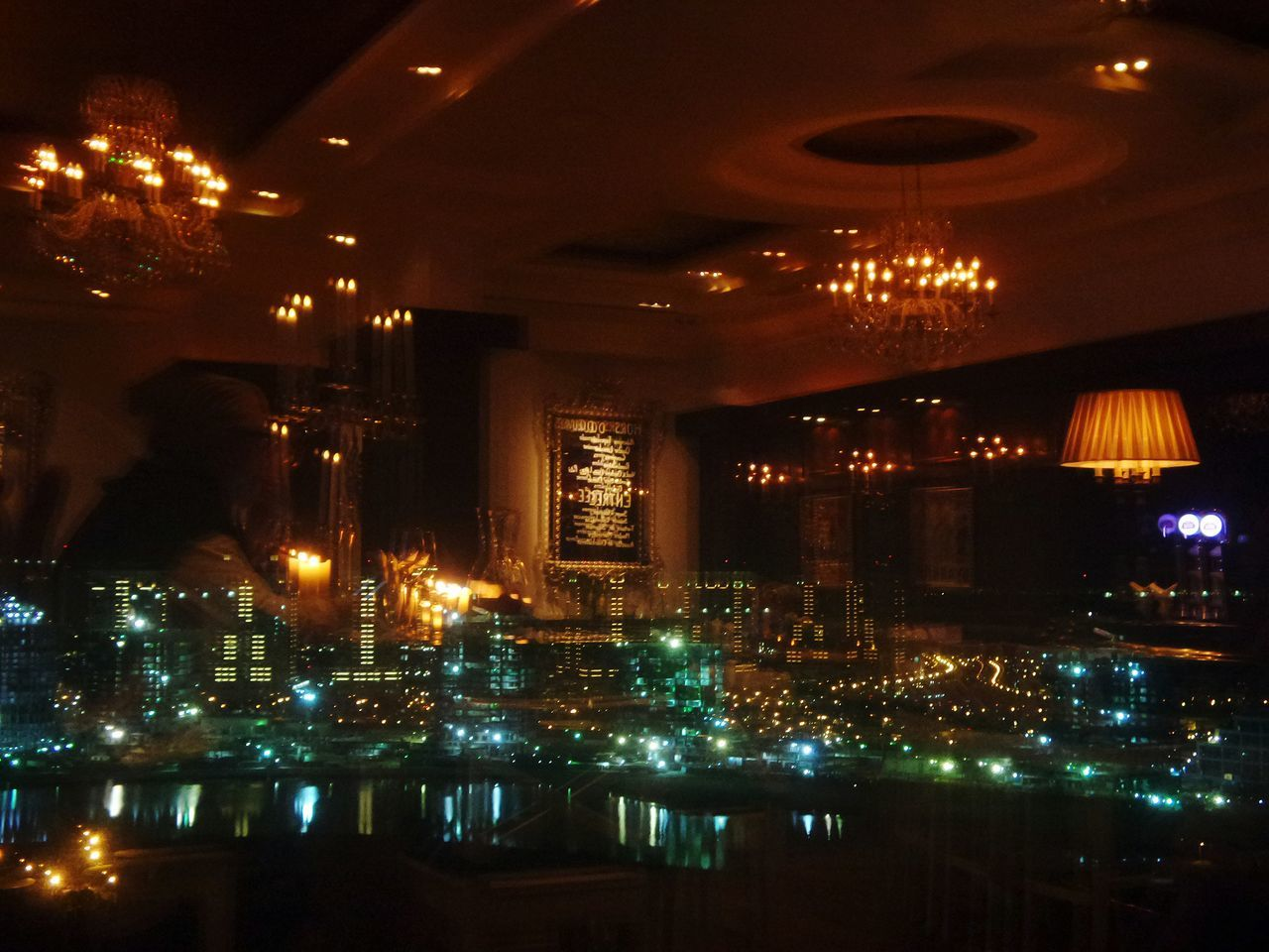 On the 23rd floor of a very nice hotel, I found this romantic French restaurant. I love the table close to the windows Embrace Urban Life Night Illuminated Indoors  Sky Skyscraper Glass Reflections Restaurant Restaurant Window Restaurant With Views