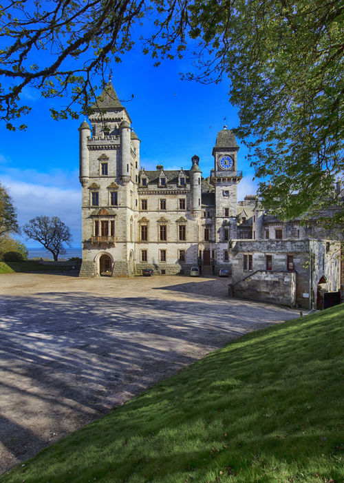 Dunrobin castle in Sutherland, from from the entrance parkway Architecture Blue Building Exterior Built Structure Castle City Clear Sky Clock Tower Cultures Day Dunrobin Castle DunrobinCastle Entrance Eye4photography  Green Historical Building History History Through The Lens  No People Outdoors Parkweg Scotland Scottish Highlands Travel Destinations Tree