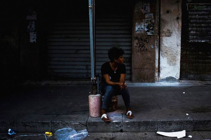 The Week On EyeEm Sitting One Person Full Length Adult Young Adult Adults Only People Real People Day Only Women Outdoors City Urban Streetphotography Migrants Street Neighborhood