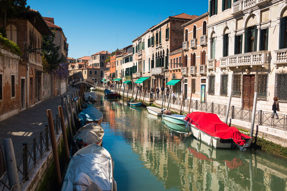Architecture Building Exterior Built Structure Canal Clear Sky Day Gondola Gondola - Traditional Boat Gondolier Italy Men Mode Of Transport Moored Nautical Vessel One Person Outdoors People Real People Sky Transportation Travel Destinations Venice, Italy Water Waterfront