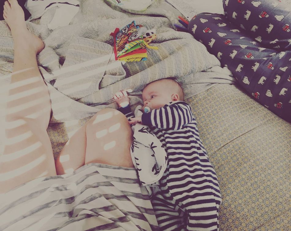 Family Lazy Sunday Babyhood Innocence Baby Real People Striped Indoors  Bed Baby Clothing Cute Full Length One Person Bedroom Childhood High Angle View Home Interior Crib Day Babies Only Domestic Life Yawning