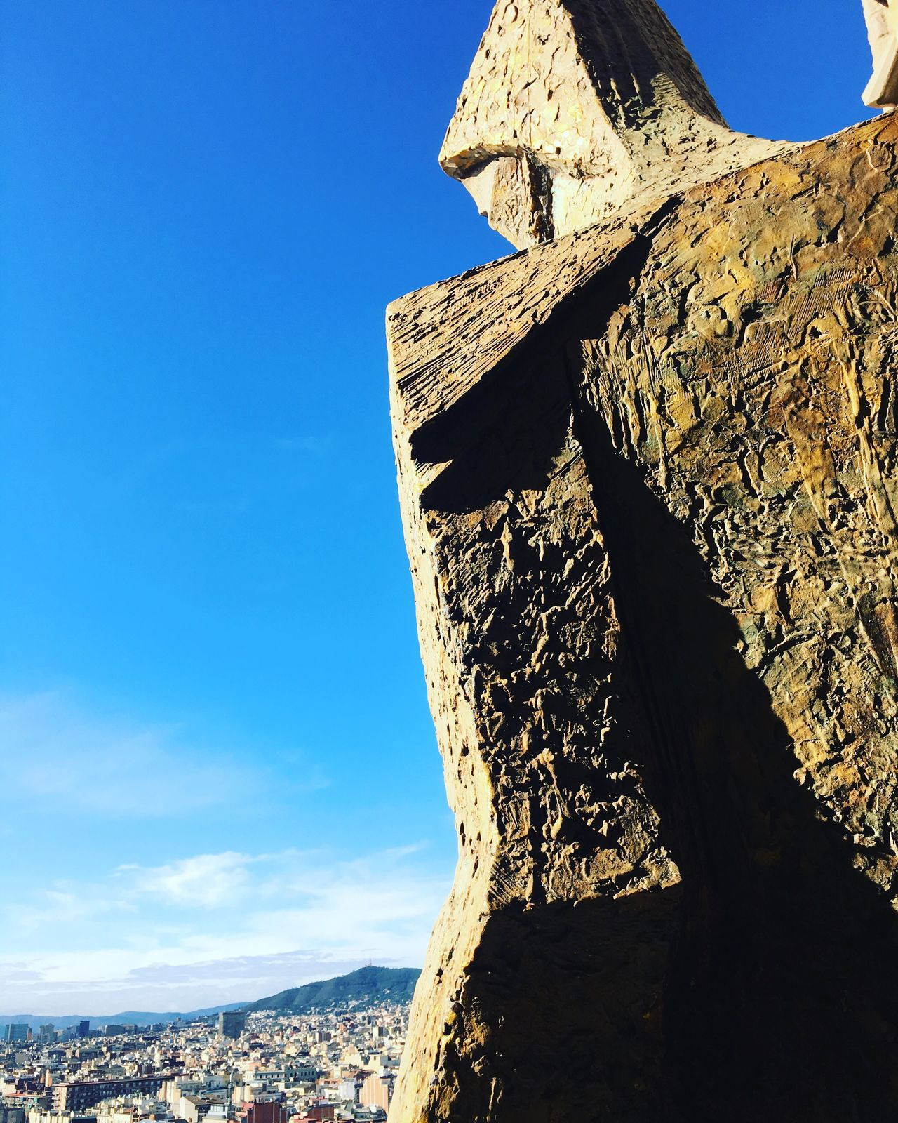 Blue Sky Low Angle View Clear Sky Sunlight Day Nature Outdoors No People Tranquility Beauty In Nature Scenics Mountain Sagrada Familia Sagradafamilia La Sagrada Familia Romantic View Contemplating Figure Contemplative Figure
