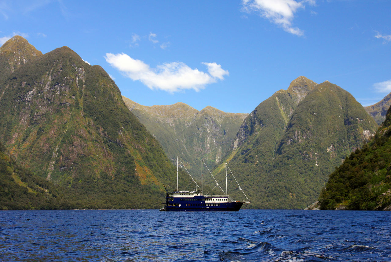 Beauty In Nature Cruise Doubtful Sound Mountain Nature Nautical Vessel New Zealand Outdoors Scenics Travel Destinations Water