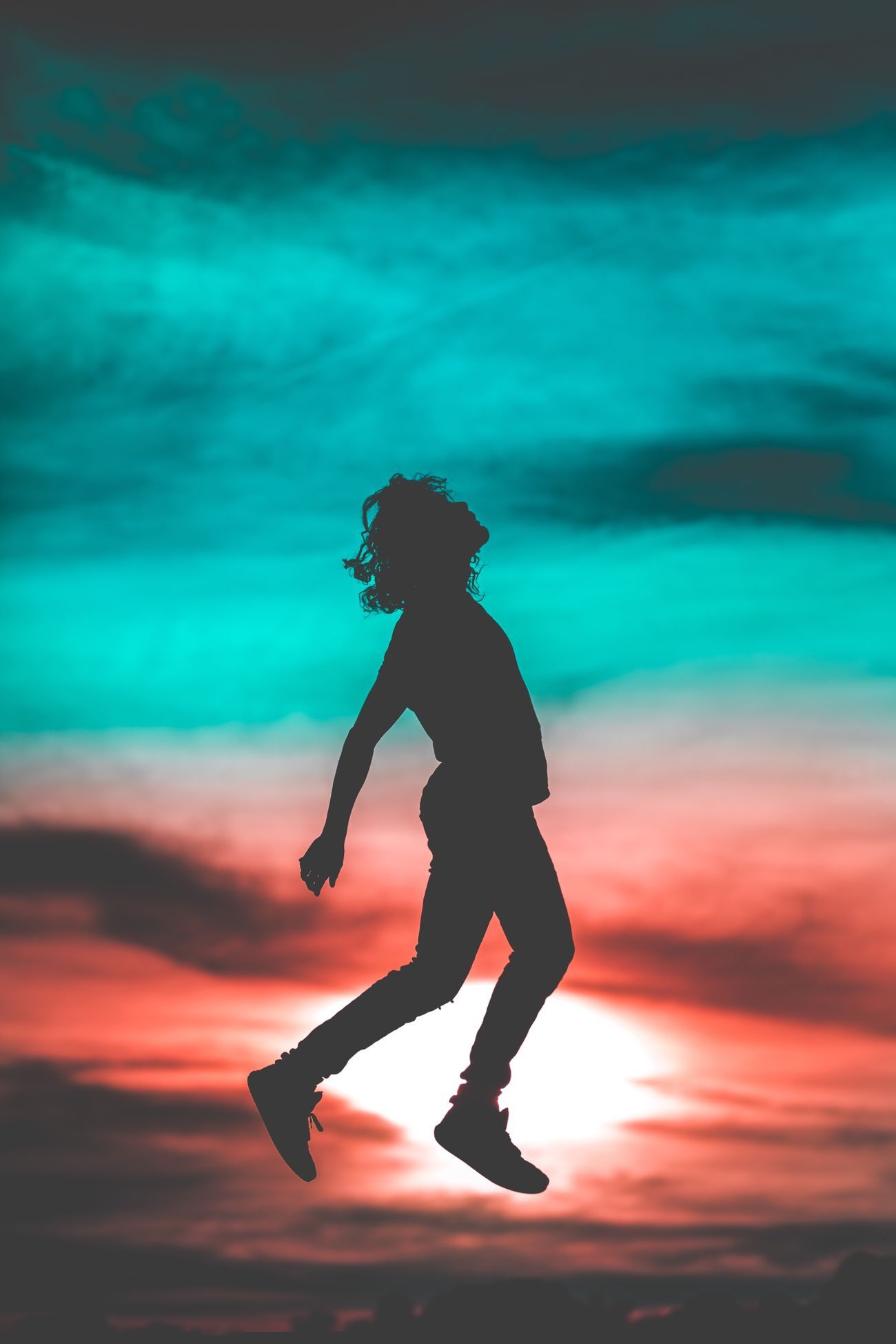 Full Length Sunset Silhouette Side View Lifestyles One Person Real People Sky Motion Water Outdoors Day