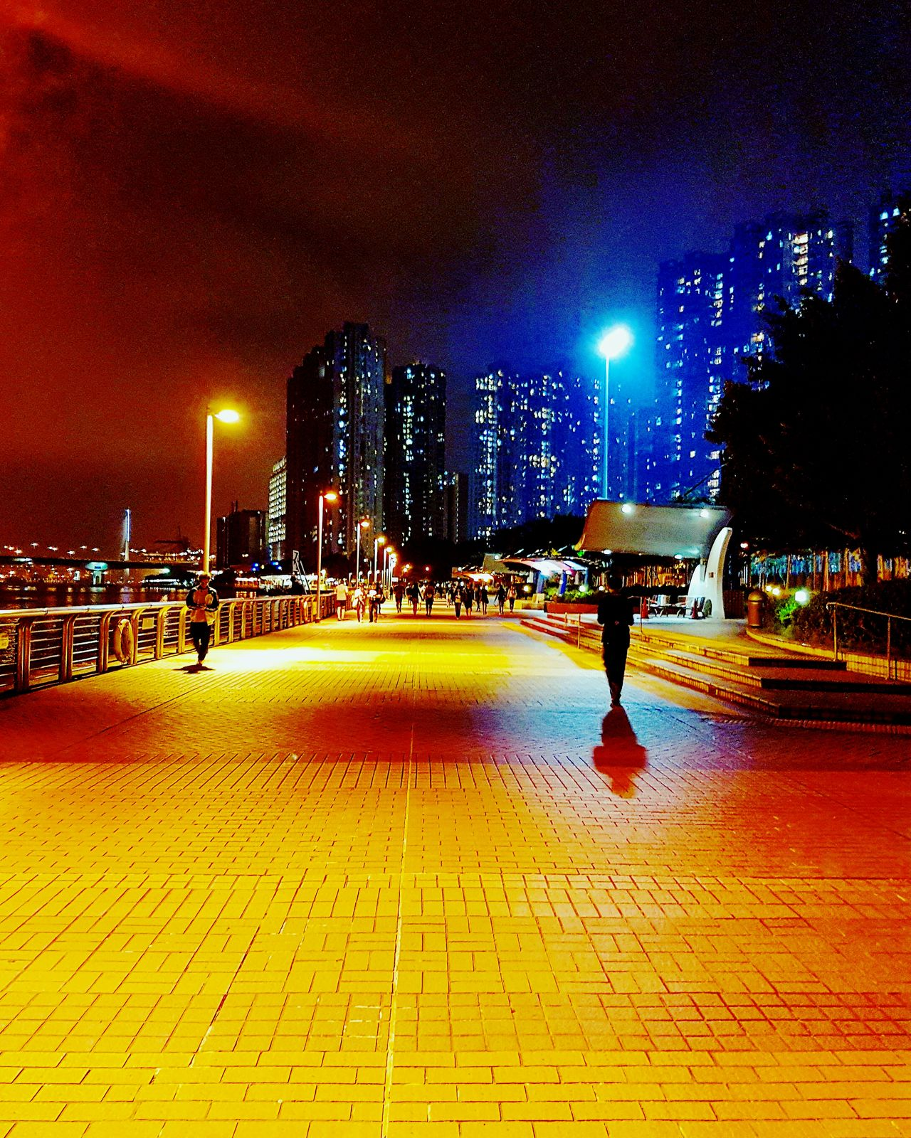 Illuminated Real People Built Structure Lighting Equipment Lifestyles One Person Night Outdoors Full Length Architecture Low Section Sky City People HongKong Seaside Nightscenes Blues Lamps Lonely 藍色街燈 VSCO S7edgephotography S7 Edge