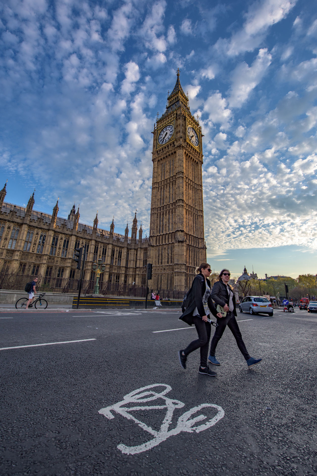 Crossing London streets Adult Adults Only Architecture Big Ben Building Exterior Built Structure Capital Clock Tower Cloud - Sky Clouds Cycling Day England Famous Building Full Frame London Outdoors People Real People Sky Standing Travel Destinations Westminster Women
