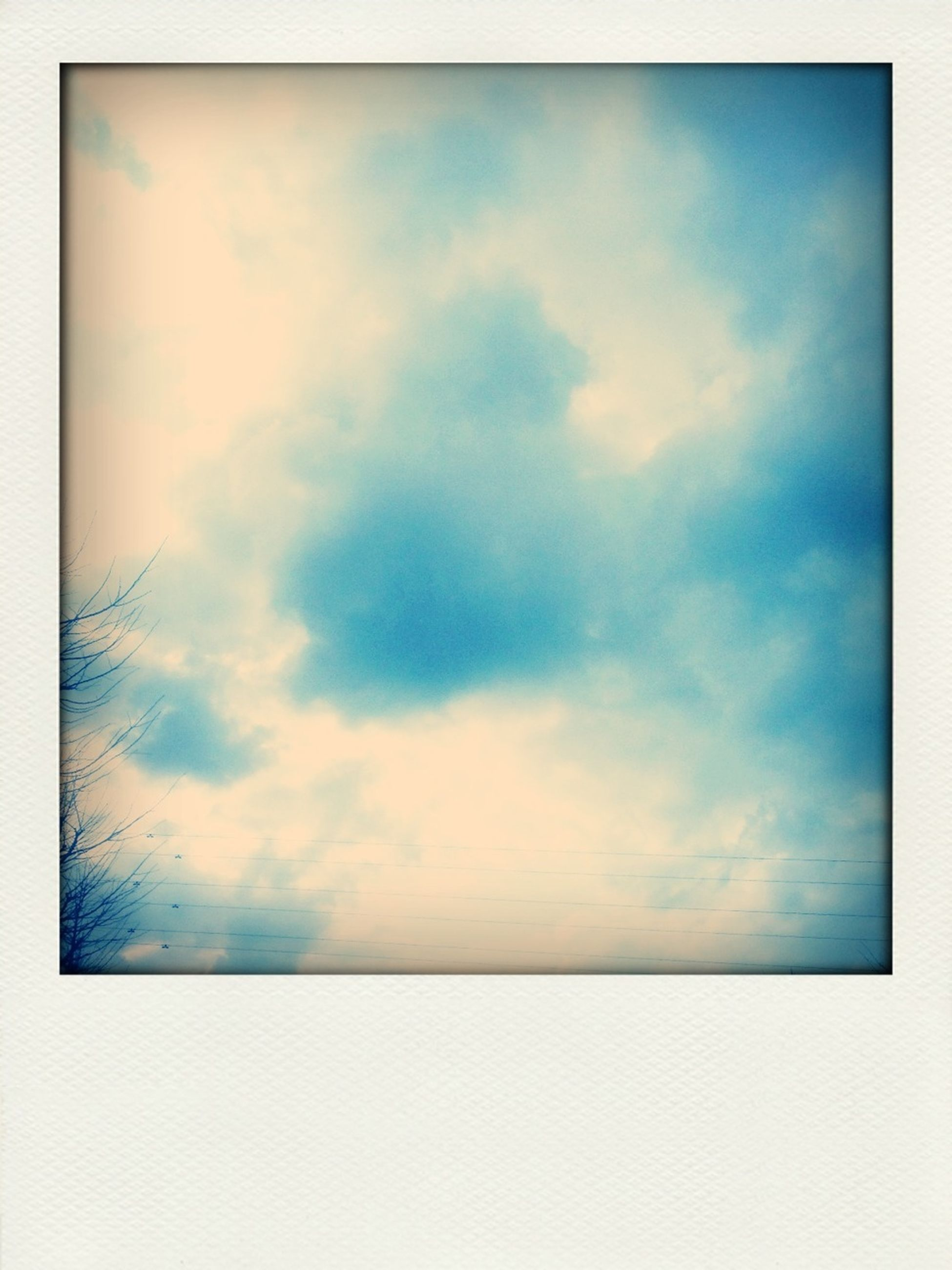 transfer print, sky, cloud - sky, auto post production filter, beauty in nature, scenics, tranquility, tranquil scene, blue, cloudy, cloud, nature, low angle view, idyllic, cloudscape, sky only, outdoors, backgrounds, no people, day