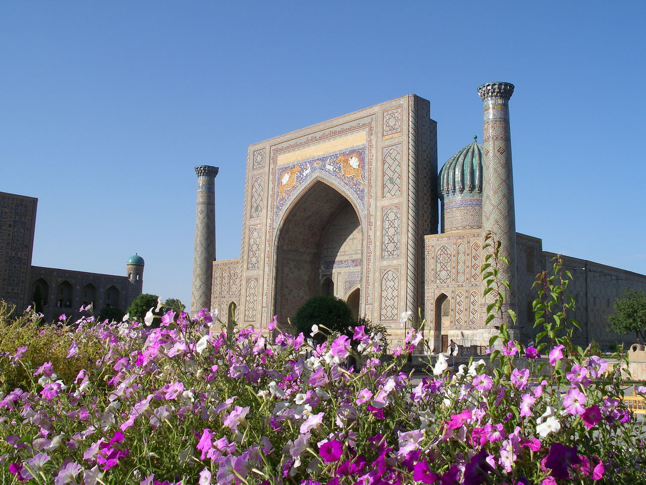 Flowers in front of a mosque in Samarkand, Uzbekistan on the Silk Road Architecture Built Structure Clear Sky Day Flower History Islam Islamic Architecture Madrassa Minarets Mosque Muslim Architecture No People Outdoors Samarkand Samarqu Silk Road Silk Road Adventure Silk Route Tree Uzbekistan Fresh On Eyeem