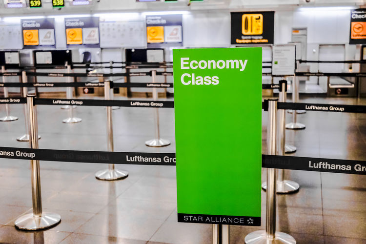 Lufthansa Economy Class Check in area in Terminal 2 Madrid Barajas Airport. Economy Green Lufthansa Passenger T2 Transportation Travel Airline Airlines Barajas Check In Close-up Departure Economy Class Editorial  Green Color Hall Illuminated Indoors  No People Text Travel Destinations