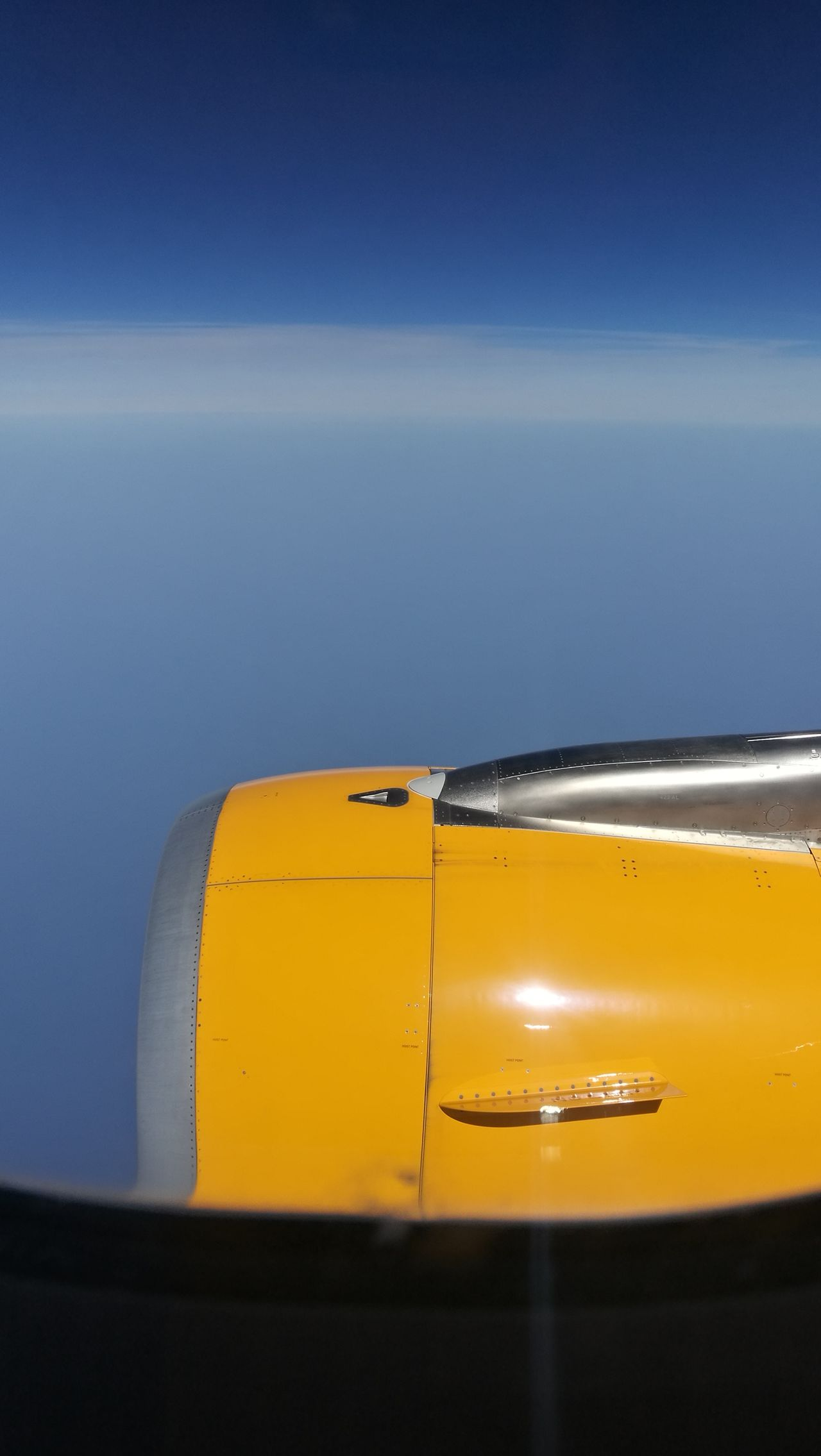 Yellow No People Sea Water Sky Plane Wing Engine Air Travel Holiday Vacation Window Outdoors Trip Sun Horizon Blue Cloud