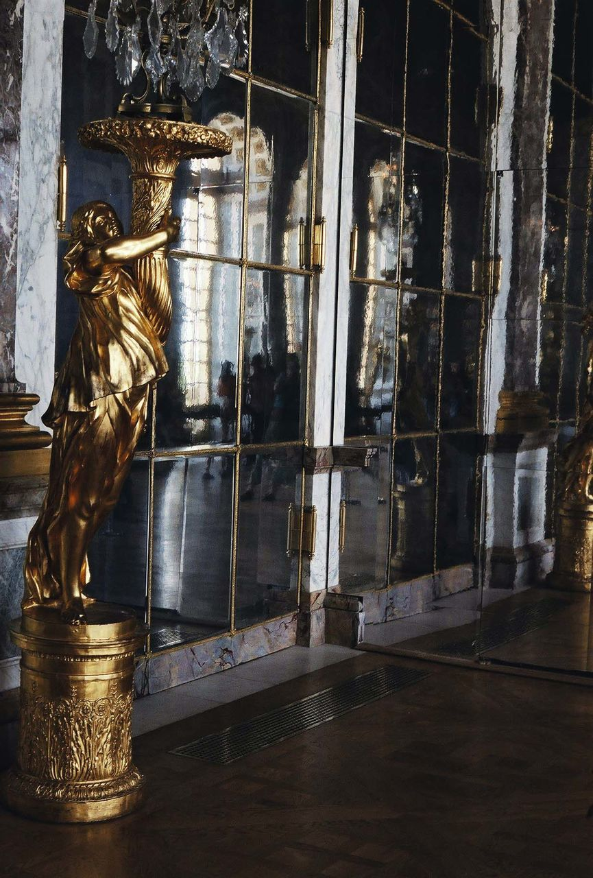 statue, sculpture, human representation, male likeness, art and craft, no people, history, indoors, gold colored, architecture, day, water, close-up
