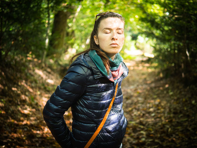 Eyes Closed  Woman Adventure Day Forest Nature One Person Outdoors People Sunlight Tree Woman Portrait Young Adult