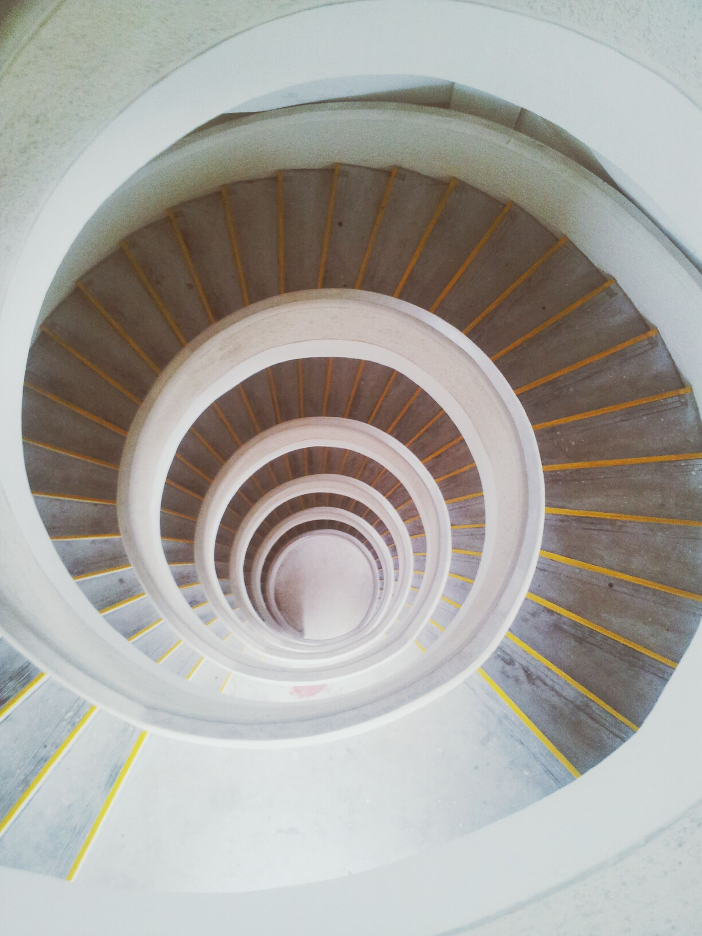 indoors, spiral, steps, railing, steps and staircases, staircase, high angle view, spiral staircase, pattern, directly above, circle, design, close-up, curve, no people, shape, geometric shape, repetition, metal, built structure