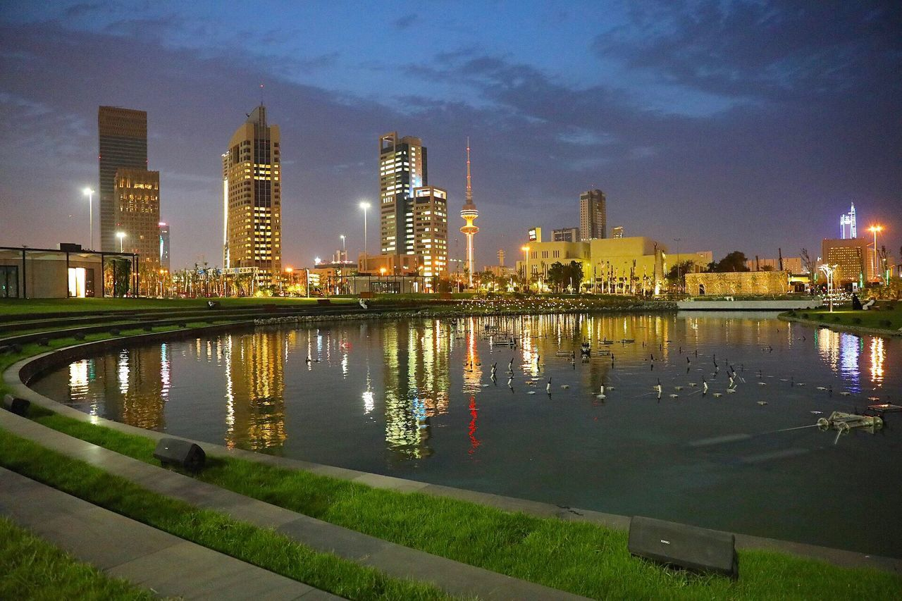 Architecture Skyscraper Water Building Exterior Built Structure Reflection City Illuminated Sky Modern River Night No People Waterfront Travel Destinations Urban Skyline Outdoors Cityscape Nature Kuwait City