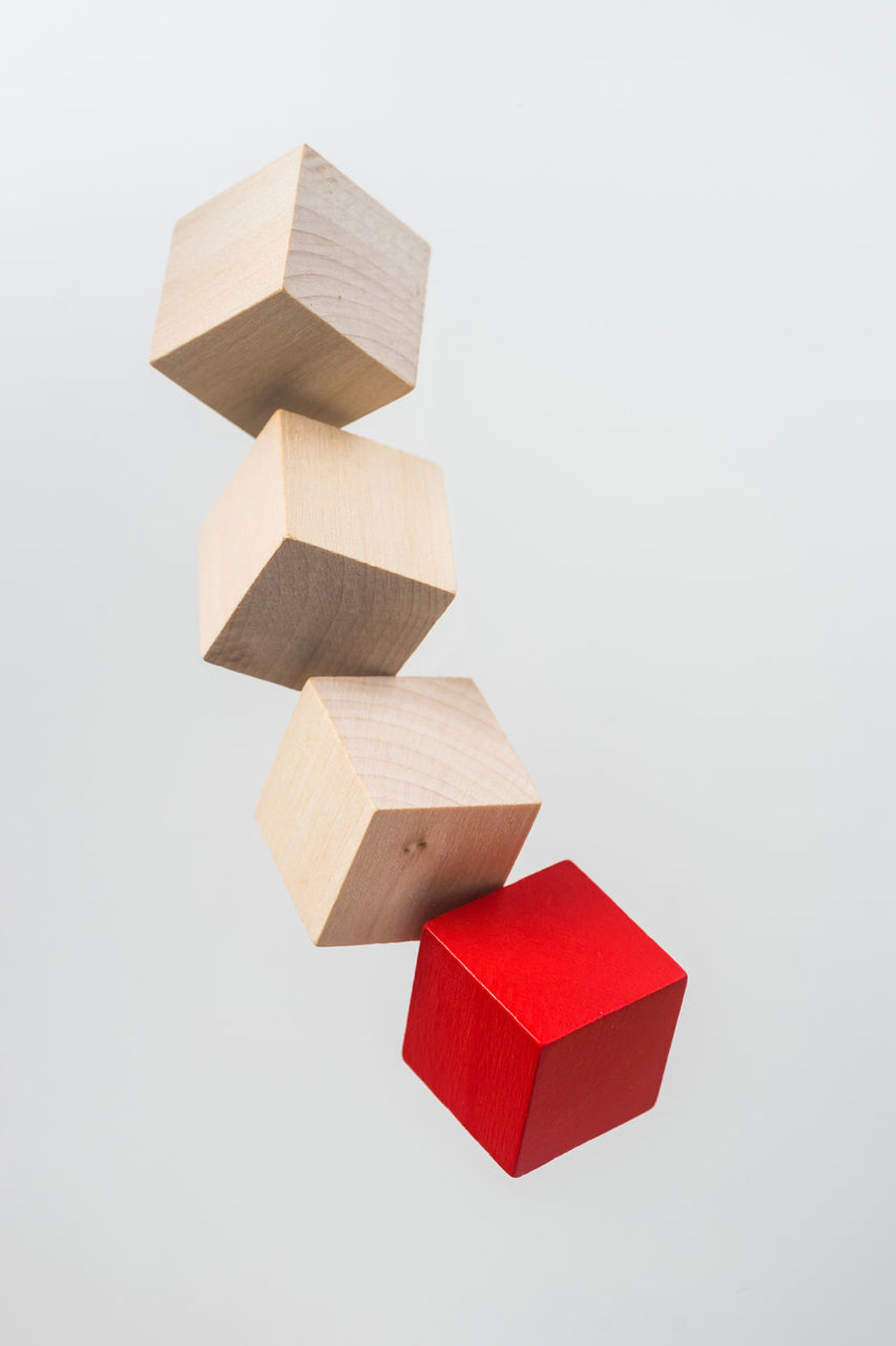 Business concept - Abstract geometric real floating wooden cube on grey background and it's not 3D render. the symbol of leadership, teamwork and growth. Balance Close-up Cube, Wooden, Wood, Float, Zero Gravity, Fly, Abstract, Geometric, Geometry, Block, Cubic, Business, Concept, Create, Design, Idea, Object, Progress, Creativity, Minimalism, Simplicity, Simple, Square, Isolated On White Background, No 3D Render, Connectio No People Puzzle  Red Studio Shot Toy Block White Background Wood - Material