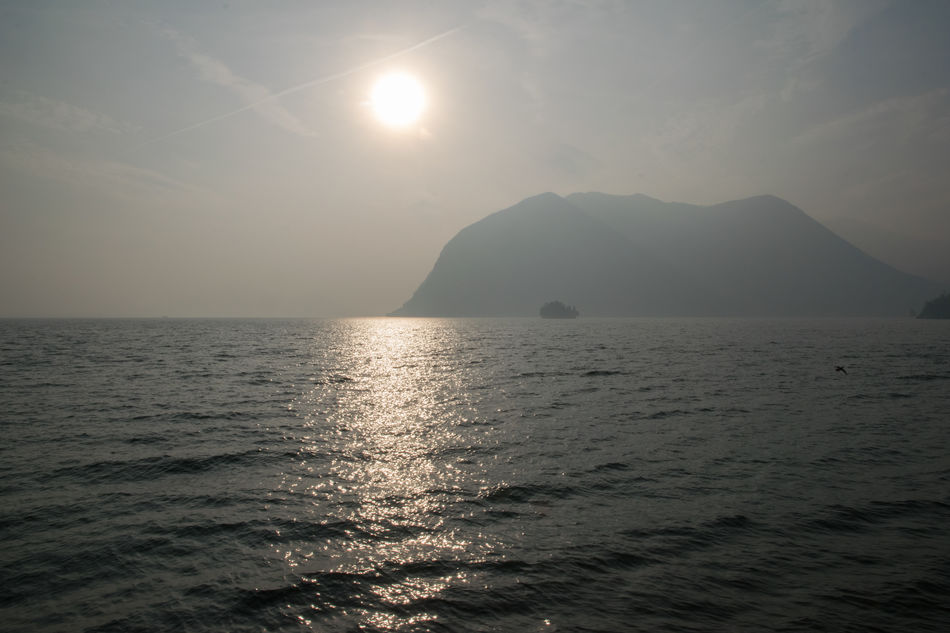 Beauty In Nature Day Landscape Mountain Nature Nautical Vessel No People Outdoors Refraction Rippled Scenics Sea Shiny Summer Sun Tranquil Scene Tranquility Water